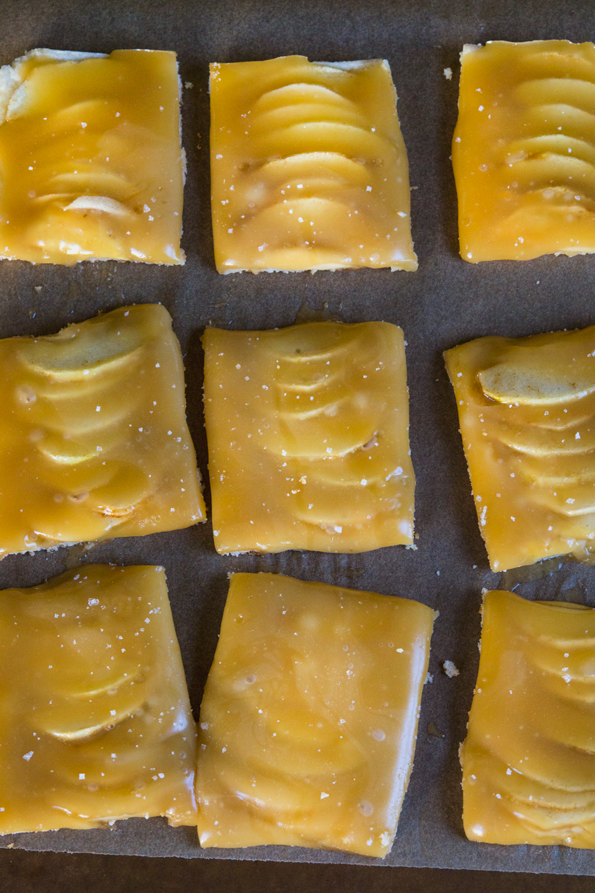 Overhead view of Caramel Apple Shortbread Squares on brown surface