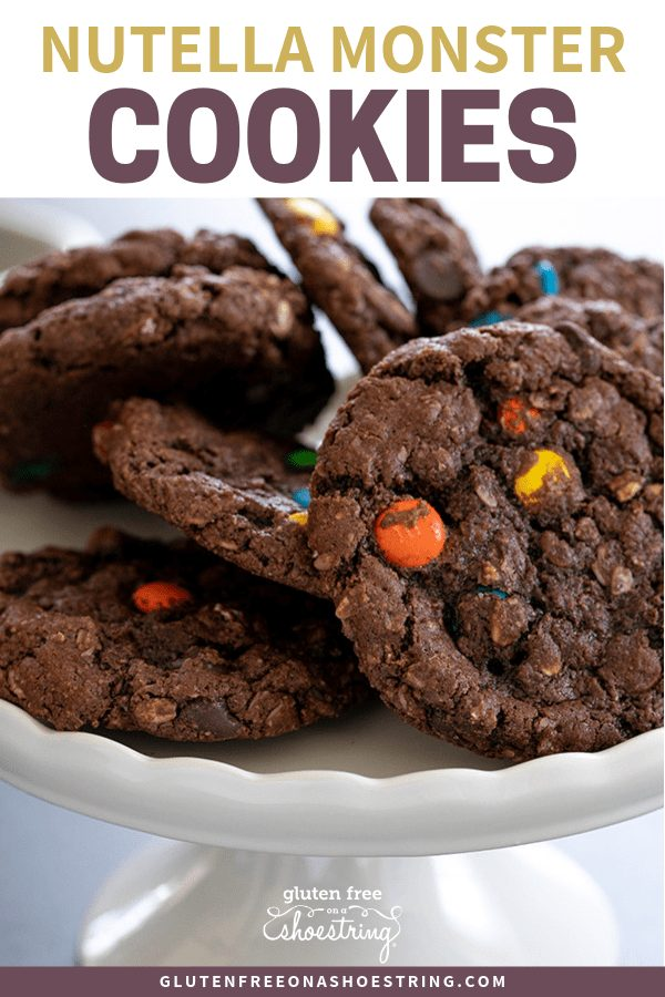 These gluten free Nutella monster cookies are like a cross between a nut butter cookie and an oatmeal cookie. Made with Nutella instead of the traditional peanut butter, they're a truly special treat. #glutenfree #Nutella #oatmeal #monster #cookies