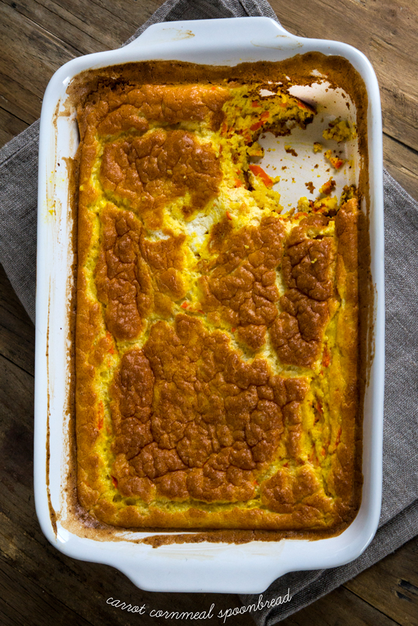 Overhead view of Carrot Cornmeal Spoonbread in white dish