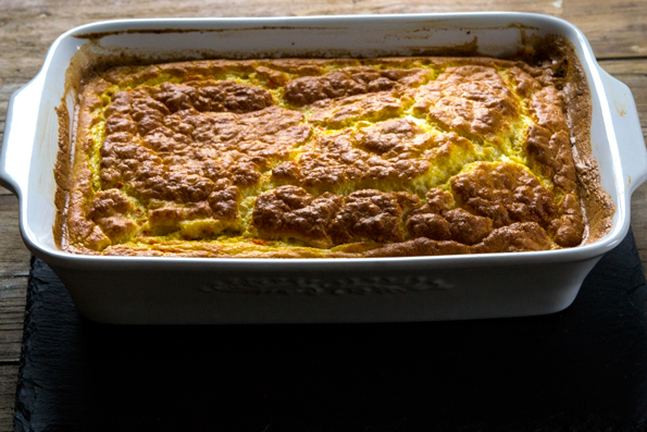 Close up of Carrot Cornmeal Spoonbread in white dish