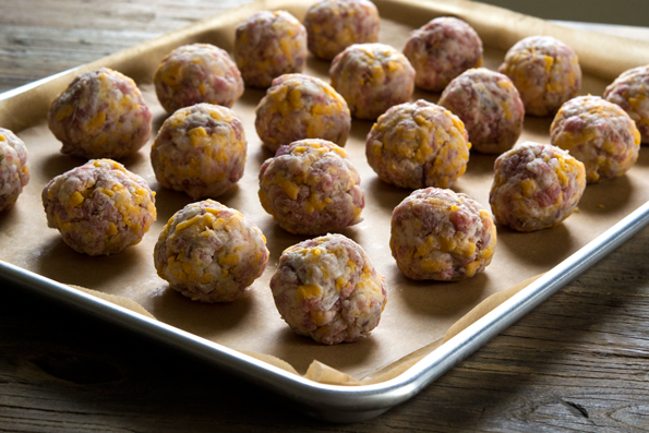Raw sausage balls on a tray