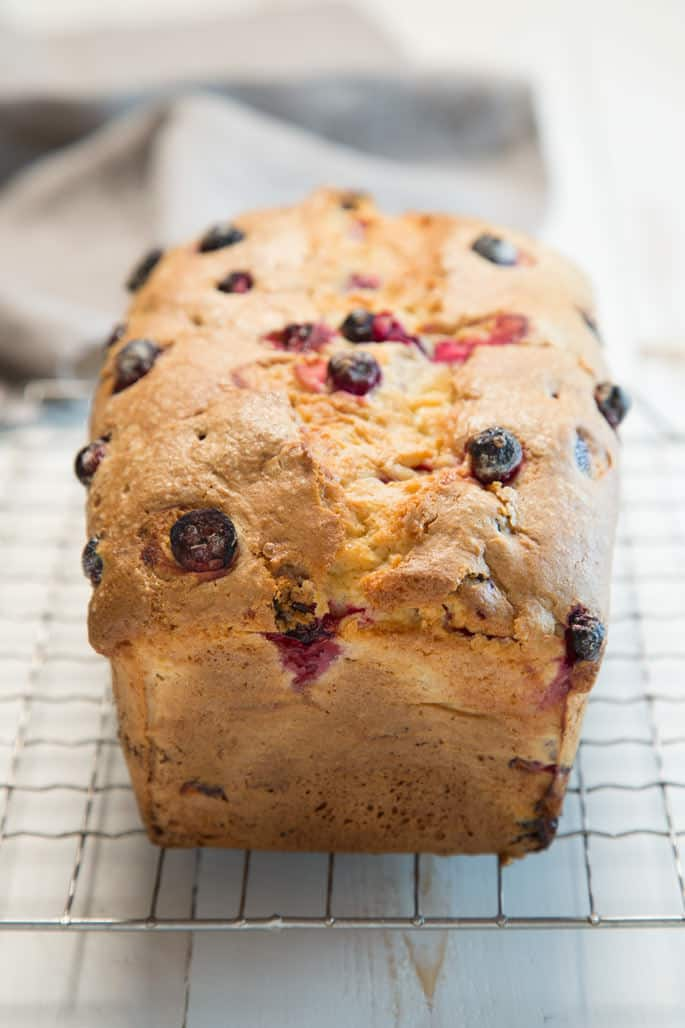 A close up of the end of a loaf of cranberry bread