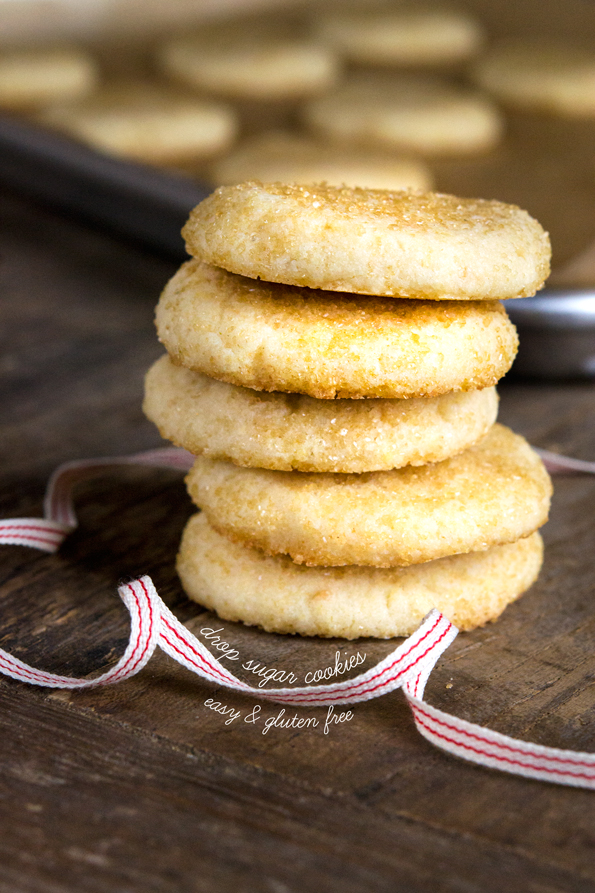 A stack of 5 drop sugar cookies with a ribbon