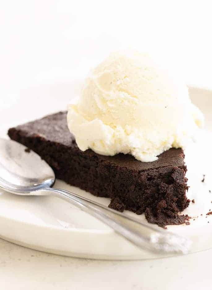 Skillet brownie on plate with ice cream and spoon