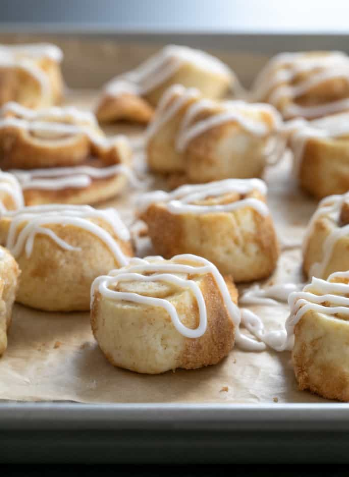 """These gluten free cinnamon roll sugar cookies somehow manage to be soft and tender, and even light and flaky. Just like a """"real"""" cinnamon roll—but in a neat little cookie."""