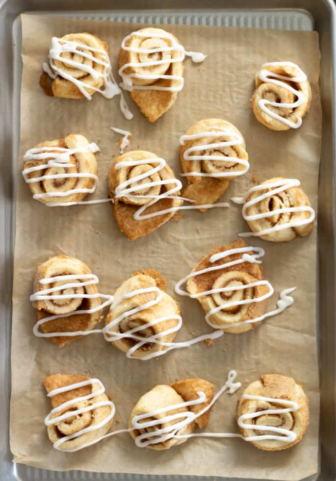 These gluten free cinnamon roll sugar cookies somehow manage to be soft and tender, and even light and flaky. Just like a real cinnamon roll—but in a neat little cookie.