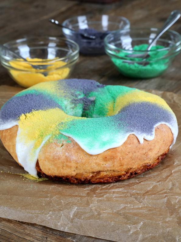 Circular king cake on brown surface