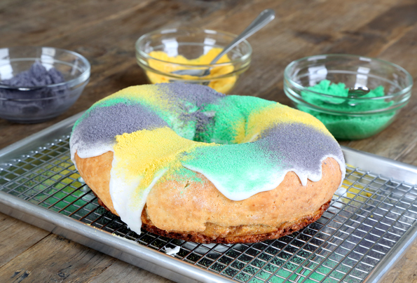 A close up of king cake on metal tray