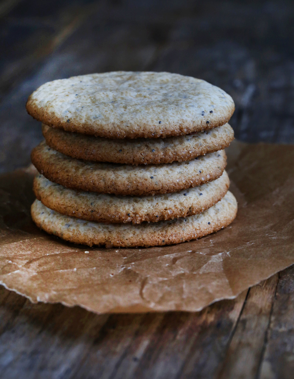 A stack of cookies on wooden surface