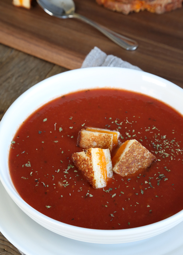 grilled cheese croutons in a bowl of tomato soup