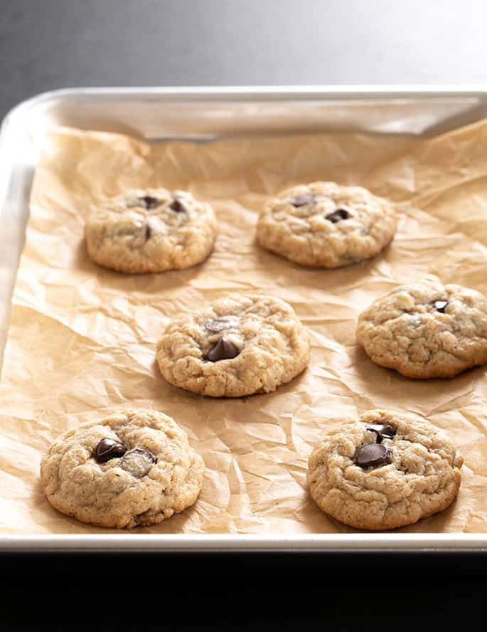 A tray of baked peanut butter oatmeal chocolate chip cookies