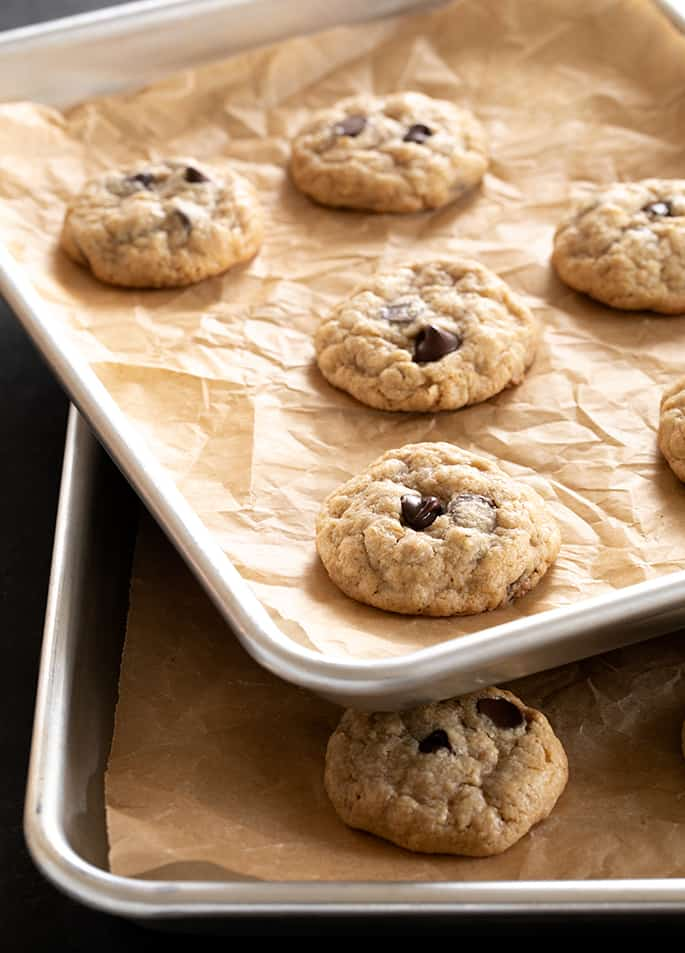 Two trays of peanut butter oatmeal chocolate chip cookies