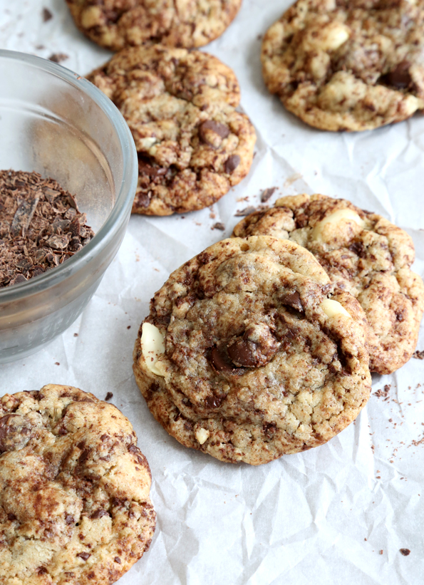 Chocolate chip cookies laying in each other on white surface