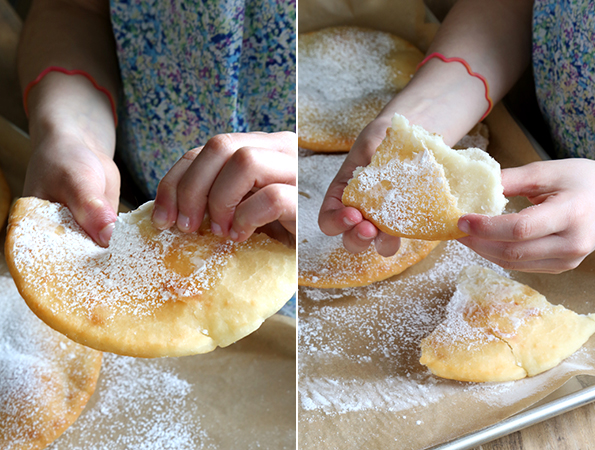 Person holding fry bread over metal tray