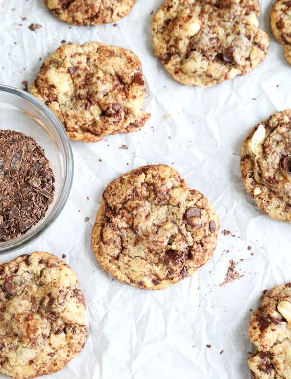 Overhead view of chocolate chip cookies on white surface