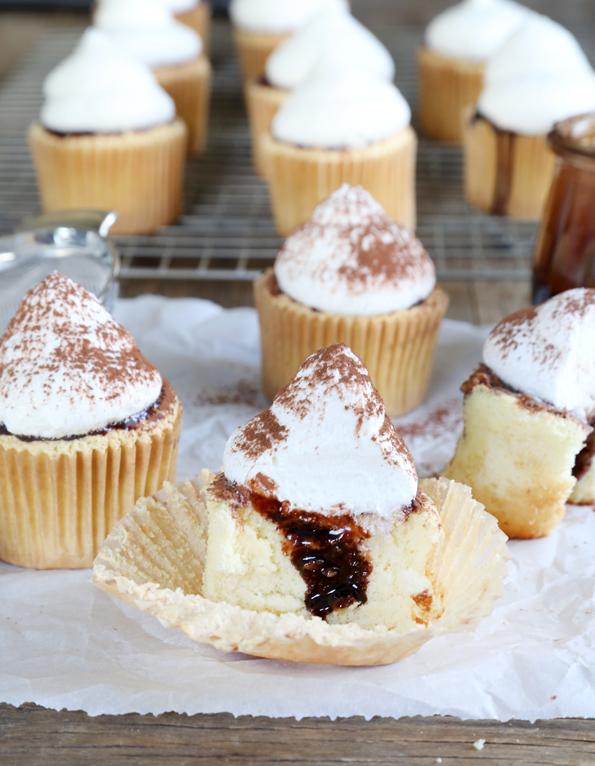 Tiramisu cupcakes on white surface
