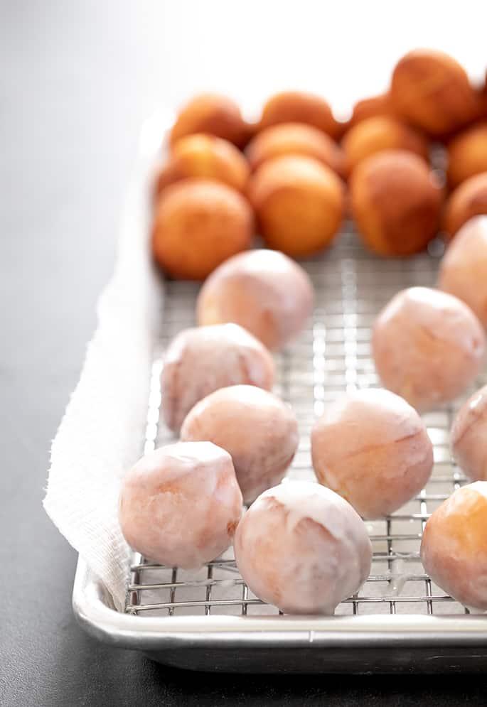 Donut holes glazed and unglazed on a tray