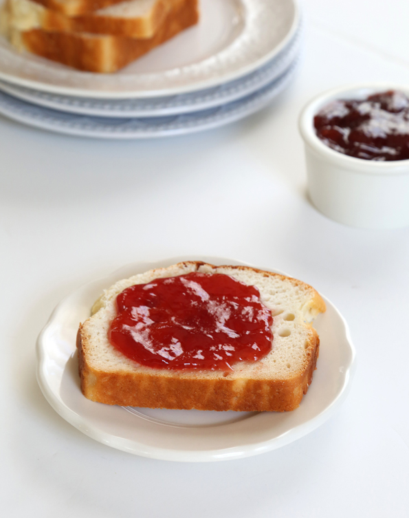 Bread with jam on a white plate