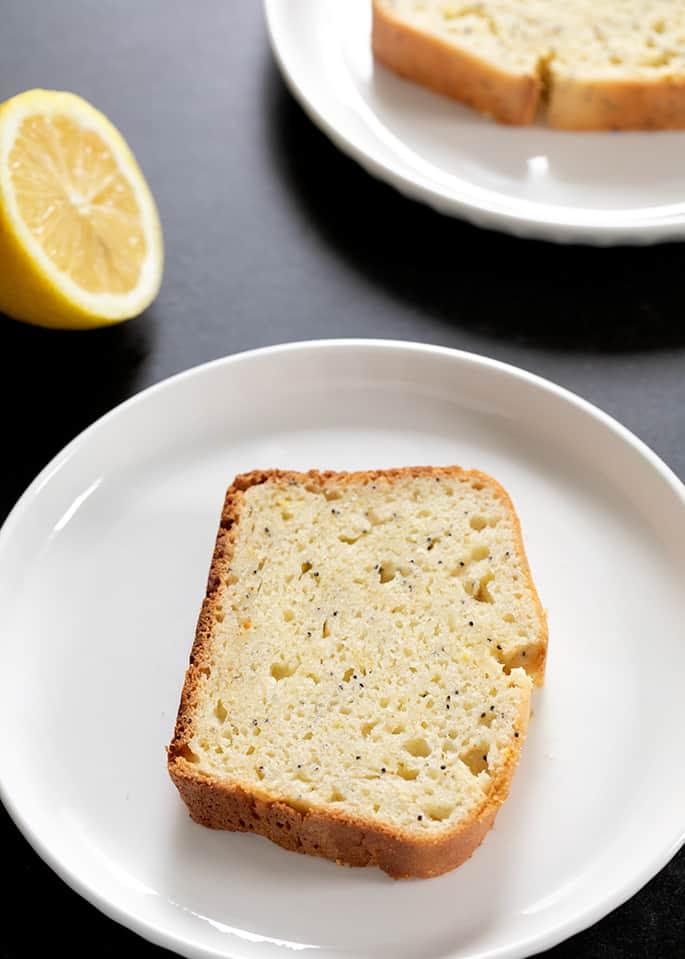 Plated gluten free lemon poppyseed bread showing moist and tender crumb inside and crisp-tender crust.