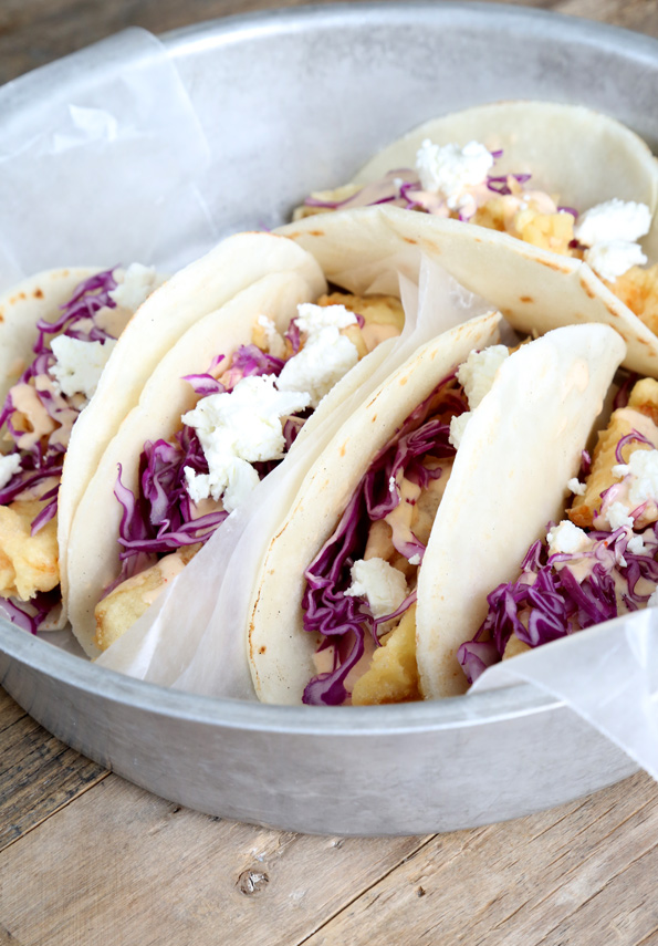 5 baja fish tacos in a metal dish