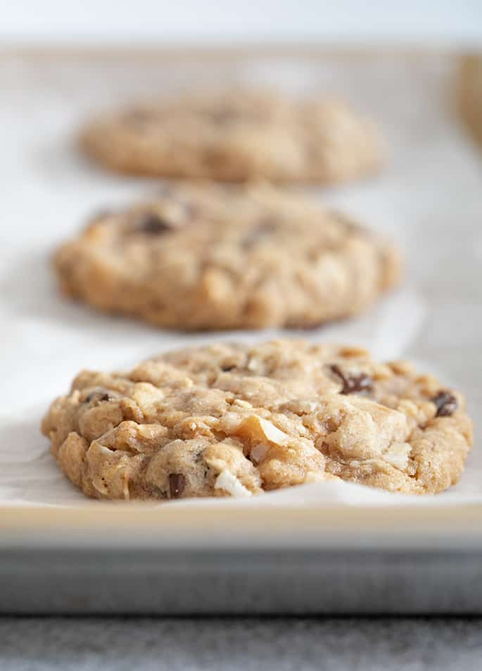 Closeup image of baked cowboy cookies on baking tray
