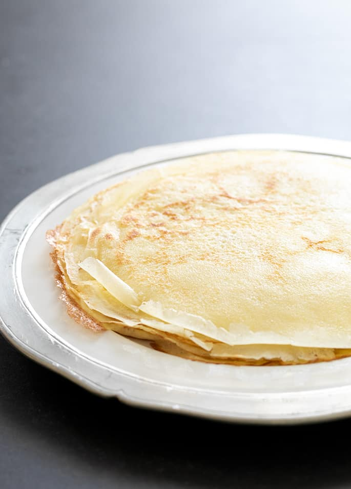 Gluten free crepes on plate in stack