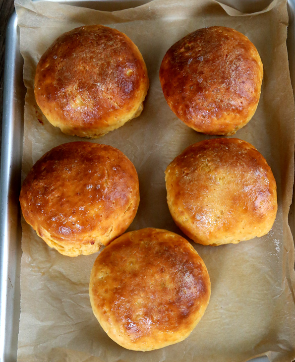 Overhead view of Sweet Potato Browned Butter Rolls on beige surface
