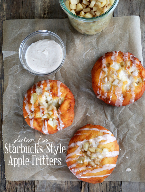 Overhead view of apple fritters on brown surface