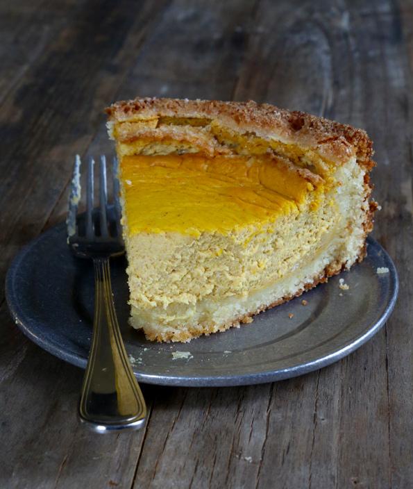 A piece of pumpkin butter cake on a silver plate
