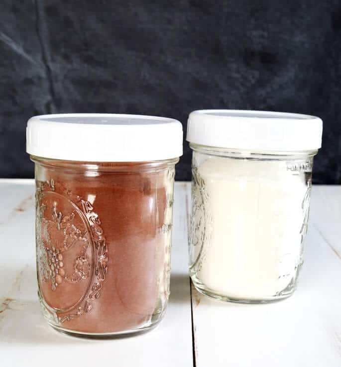 Pudding mix in 2 jars on white surface