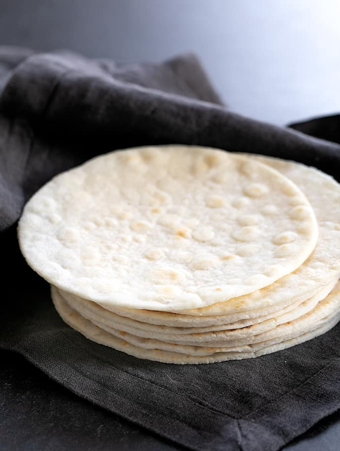 A neat stack of Paleo tortillas in cloth