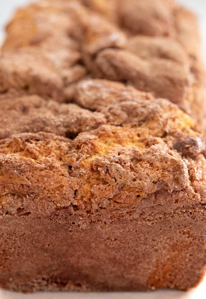 Whole baked loaf of cinnamon swirl bread closeup image