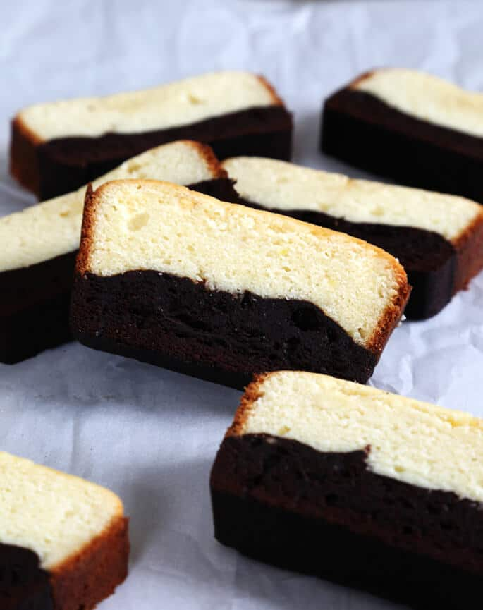Slices of brownie butter cake on a white surface