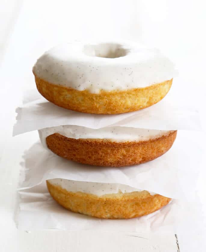 These gluten free glazed vanilla bean donuts are soft, moist and tender, and bake up in minutes. They're basically the perfect vanilla donut.