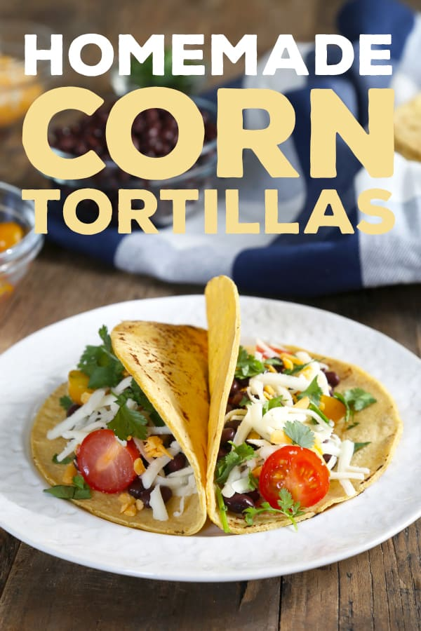 Two corn tortillas with bean taco filling