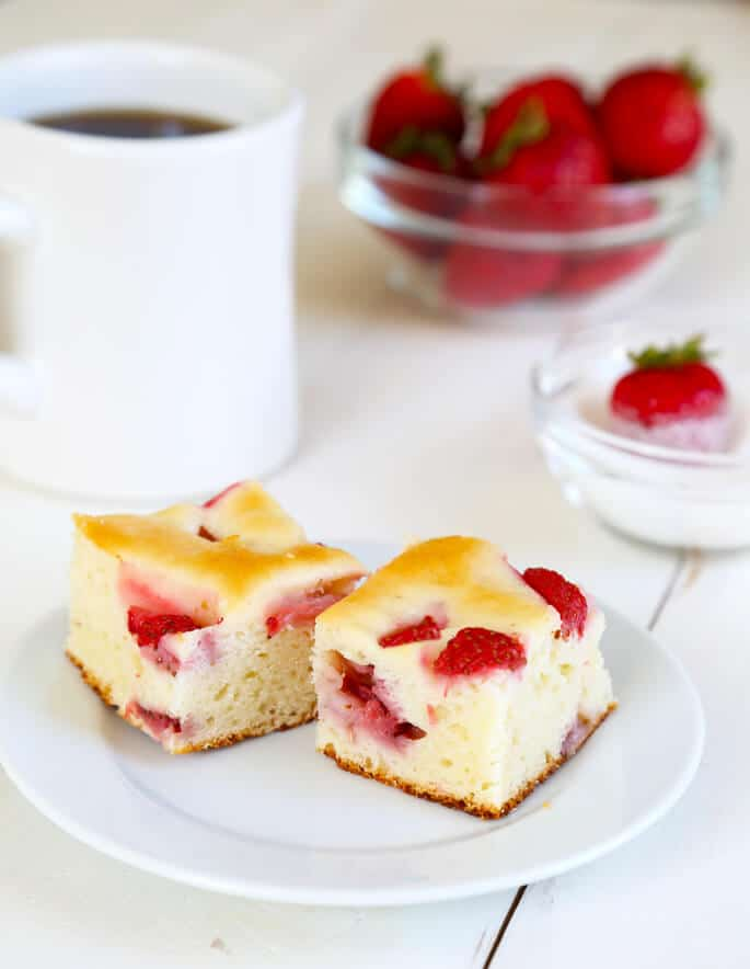 Two small pieces of gluten free strawberry breakfast cake on a small plate