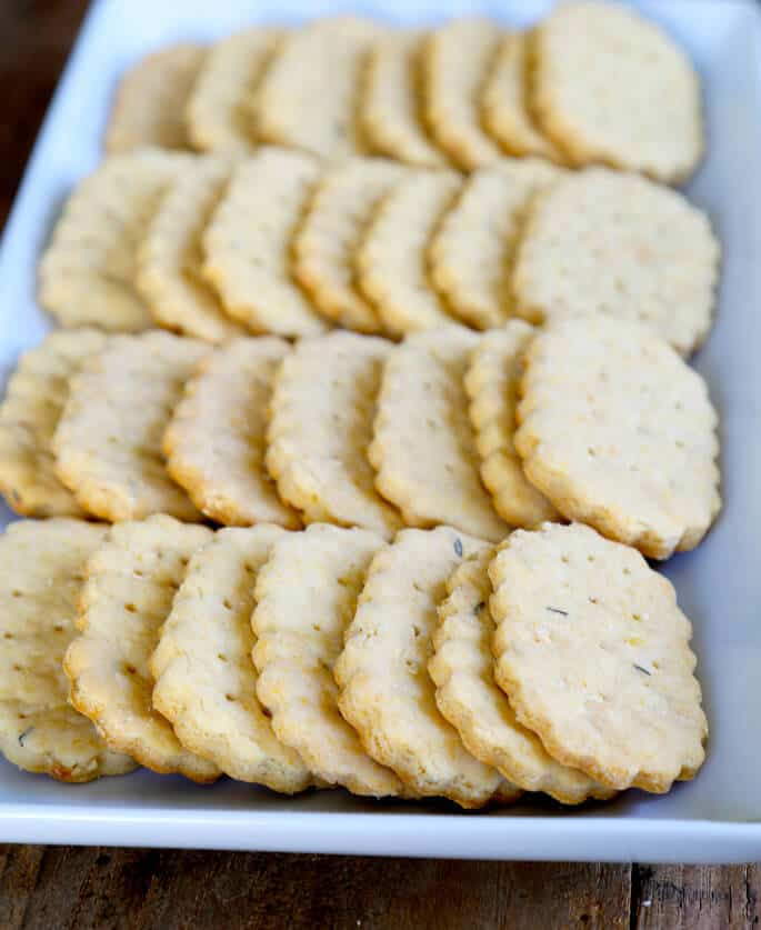 4 rows of crackers on white plate