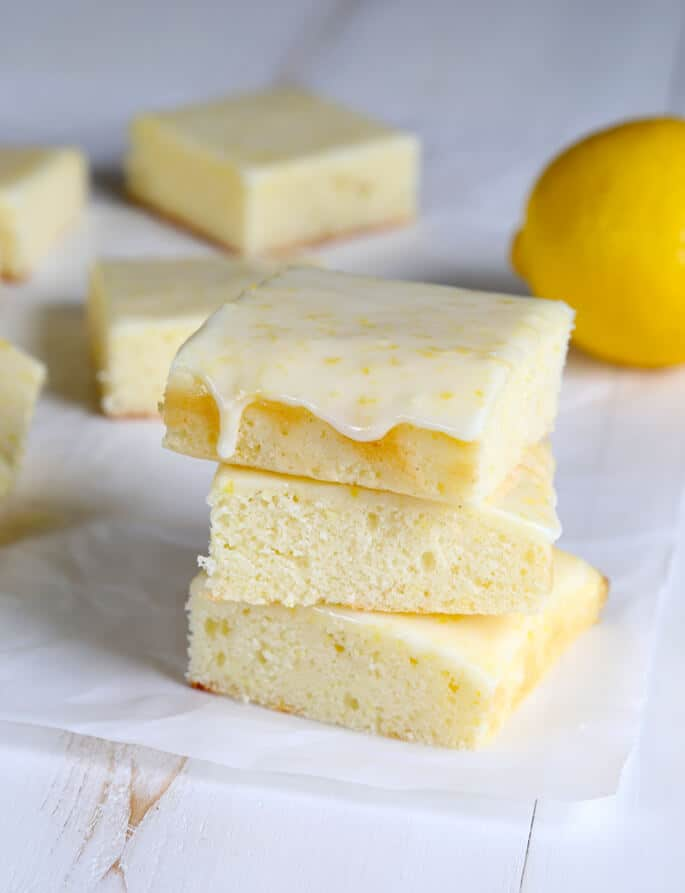 A stack of 3 lemon brownies on white surface