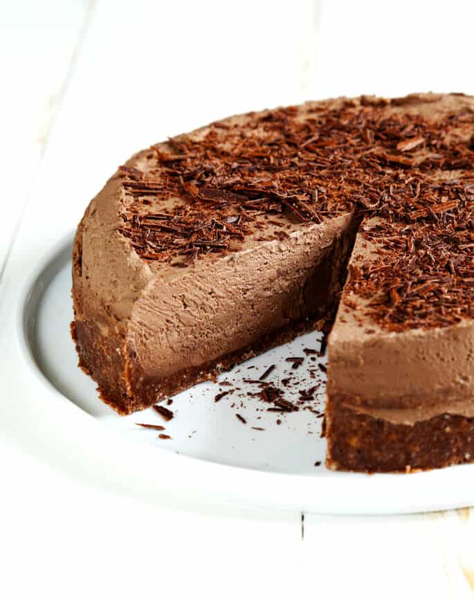 A light and fluffy, mousse-like no bake gluten free chocolate cheesecake that isn't too rich or too sweet—and can be made with or without a simple cookie crumb crust.