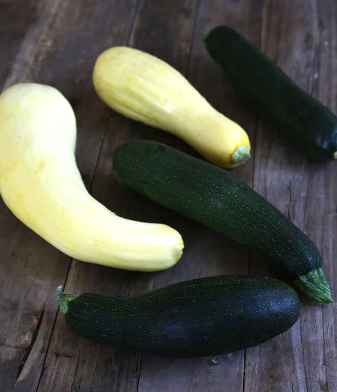 Zucchini and squash on a wooden surface