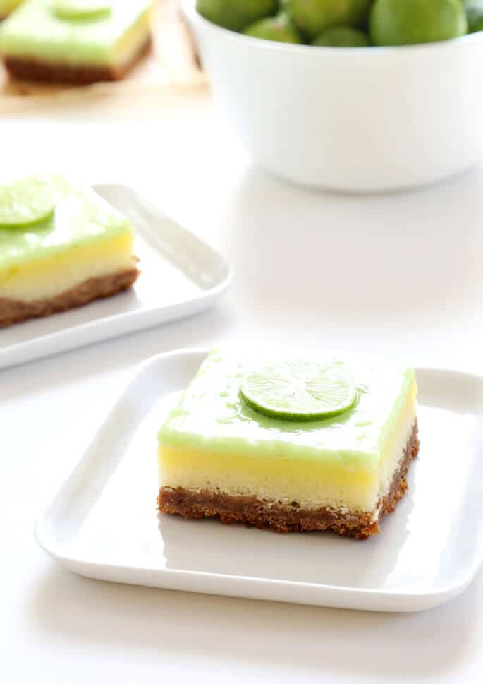 A close up of a key lime pie bar on a white plate