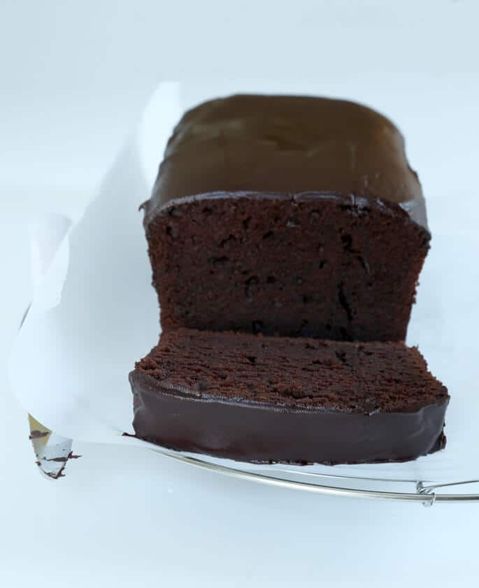 Chocolate pound cake on a white surface