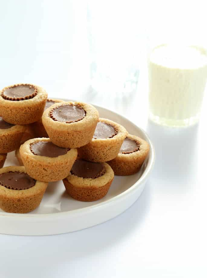 White plate with stacks of peanut butter cup cookies