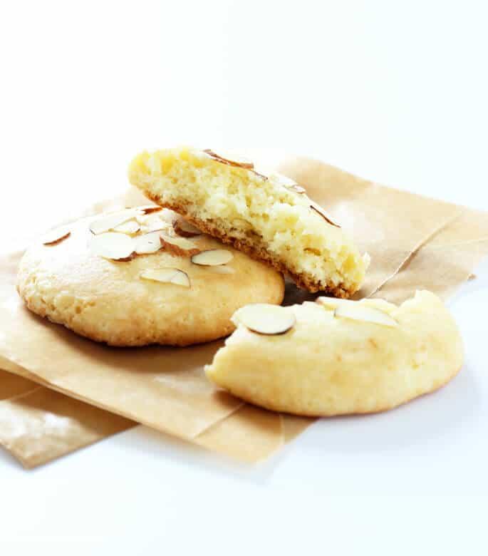 2 almond cookies on brown paper