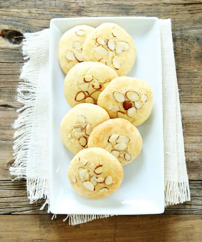 Overhead view of almond cookies on a white plate
