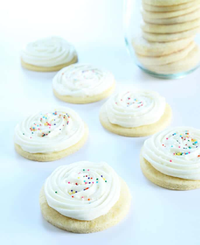 Soft and tender gluten free cream cheese cutout sugar cookies with slightly firm Lofthouse-style frosting. Basically, they're the perfect cookie.
