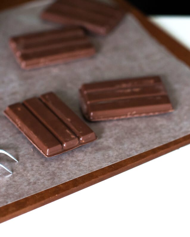 ""\""""kit kat"""" bars on a wooden surface""638|798|?|en|2|93b690406e9b489ed6e0ff4a49a466c7|False|UNLIKELY|0.3125147223472595