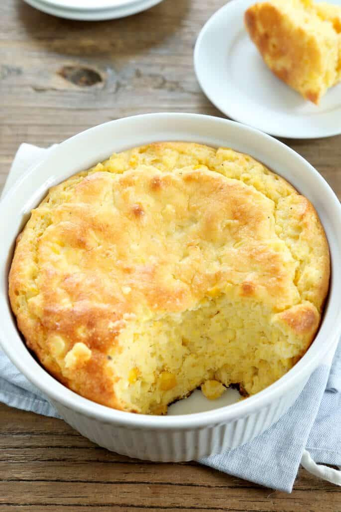Cornmeal spoonbread in a round casserole dish
