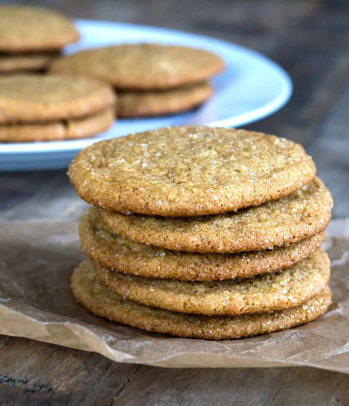 Stack of 5 ginger cookies on parchment paper