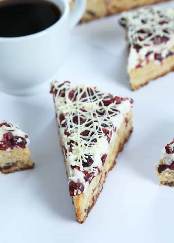 Cranberry bliss bars on a white surface